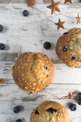 blueberry muffins and stars in rustic setting closeup