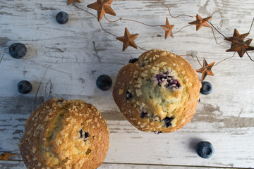 closeup blueberry muffins and stars in rustic setting