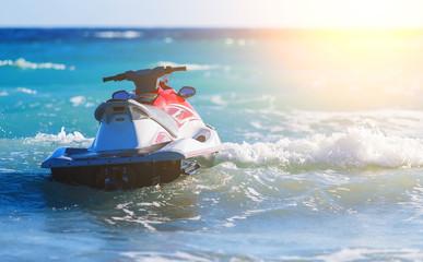 Jet Ski Moored inon on waves of sea