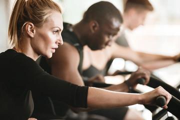 Group of multiracial young women and men exercising