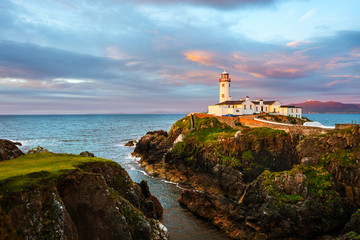 Fotobehang Vuurtoren Fanad head at Donegal, Ireland with lighthouse at sunset