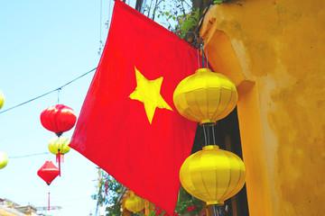 Vietnamese National Flag in Da Nang. Vietnam. Colorful silk lanterns in the foreground.