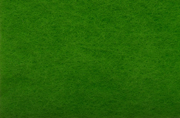 Green felt as background or texture.