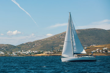 Yachting. Boat in sailing regatta. Luxury yachts.