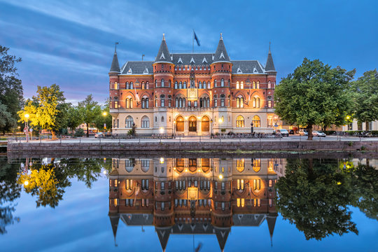 Orebro city in Sweden. Beautiful old building from 19th century in the evening, architectural landmark located on the embankment of Svartan river.
