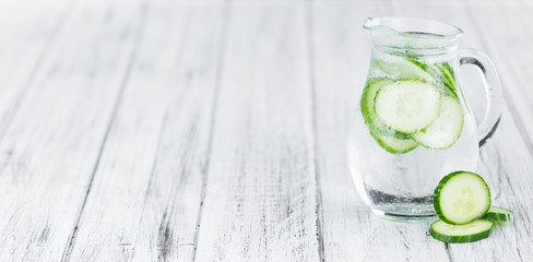 Fresh made Cucumber Water on a rustic background