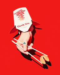 hand emerging from takeout container, holding fortune cookie with chopsticks, on red background, conceptual