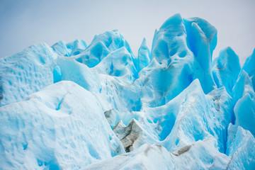The blue glacier rises and shines. Shevelev.