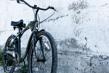 Urban Bicycle Parked Near Old White Wall, Daily Lifestyle Urban Concept