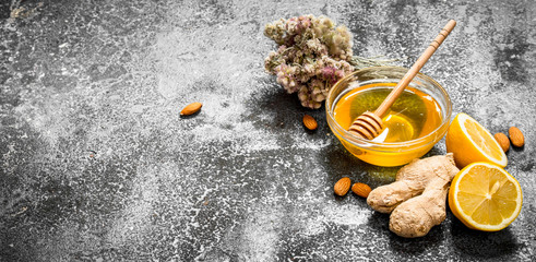 Wall Mural - Honey background. Honey with ginger, lemon and herbs.