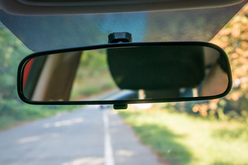 Car interior with rear view mirror and windshield