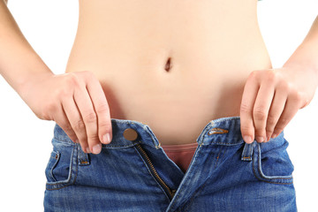 Young woman in tight jeans on white background, closeup. Weight loss concept