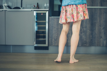 Woman with bare legs in kitchen