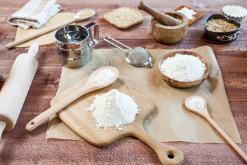 wheat and flour on rustic wooden table
