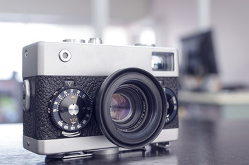 vintage manual rangefinder film camera in two-tone black&silver, shallow depth of field, filter effect