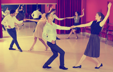 People practicing lindy hop movements