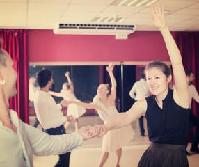 Joyful group people dancing lindy hop in pairs
