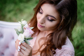 Look from above at woman with white roses in her arms