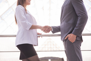 Close-up of shaking hands after a business meeting in the office. Business concept.
