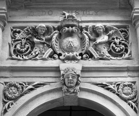 carvings on the entrance above the door of halifax town hall a former court with emblems and a figure of justice