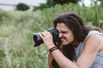 Traveler nature photographer with camera