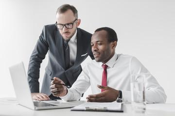 multicultural businessmen working together