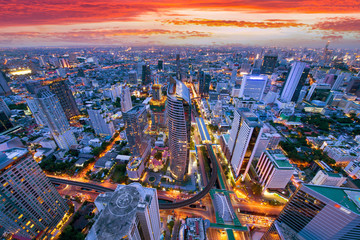 Bangkok business district aerial view skyline with sunset time.