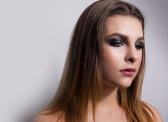 Fashionable portrait of a girl model. Fashion, smoky eyes makeup.
