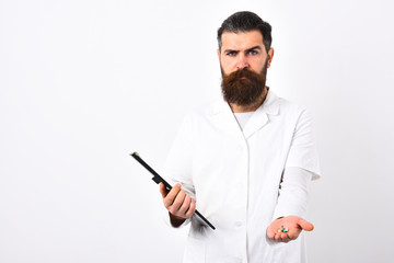 Medical worker with stylish haircut holds black folder