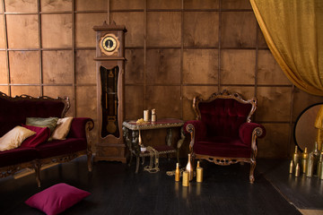 Interior with antique red furniture and clock.