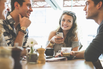 Friends talking in coffee shop