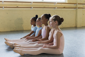 Girls sitting on floor at ballet training