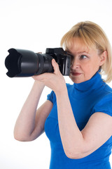 woman is holding a digital camera