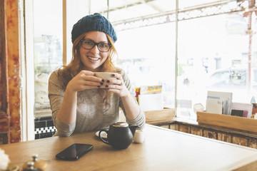 Caucasian woman drinking coffee in coffee shop
