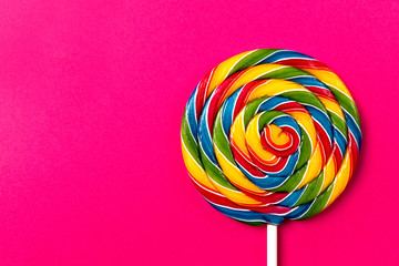 Tasty appetizing Party Accessory Sweet Swirl Candy Lollypop on Pink Background Top View
