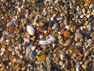 small wet colorful pebble stones background