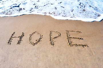 A word of hope on the beach background