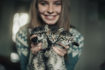 Caucasian woman holding kittens