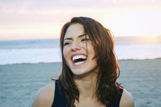 Portrait of laughing Caucasian woman at beach