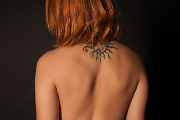Tattoo on woman's back, body part