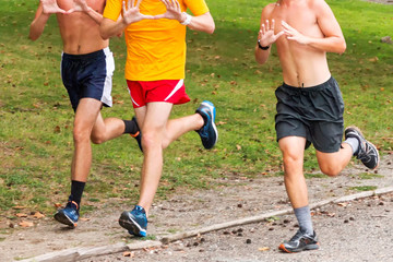 Three teenage boys training for cross country running