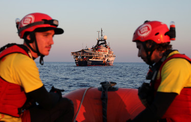 Lifeguards of the Spanish NGO Proactiva Open Arms are seen onboard a RHIB as they are moving towards the Phoenix vessel of the Maltese NGO MOAS in central Mediterranean Sea