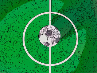 Toy soccerball in a midfield, in the center of the green field..