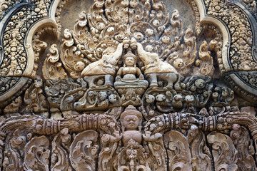 Cambodia. Siem Reap. Carved stone patterns on temple walls Banteay Srey (Xth Century)..