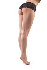 Long beautiful female legs. Isolated on white