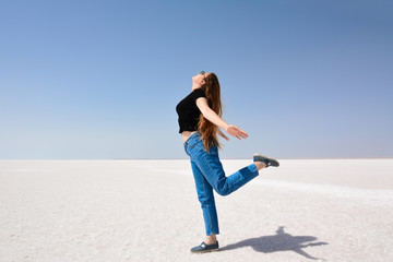 On the salt lake, the happy young girl.