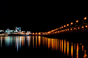 Night European city lights are reflected on the water. Kazan in Russia