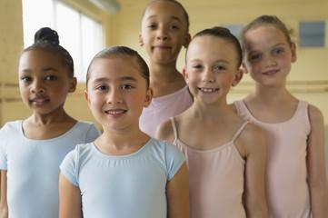 Portrait of smiling girls in ballet studio