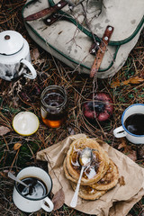 Toast with pine tip honey, and freshly brewed coffee for breakfast. Temperate coniferous forest, wild camping