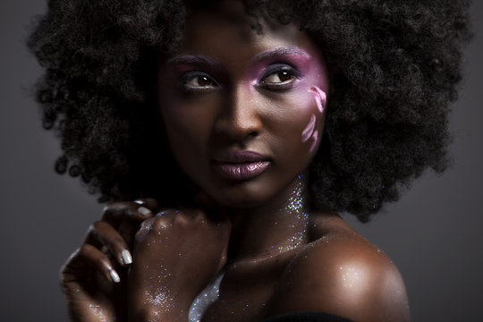 Afro and Flower beauty  with big black hair smooth dark skin
